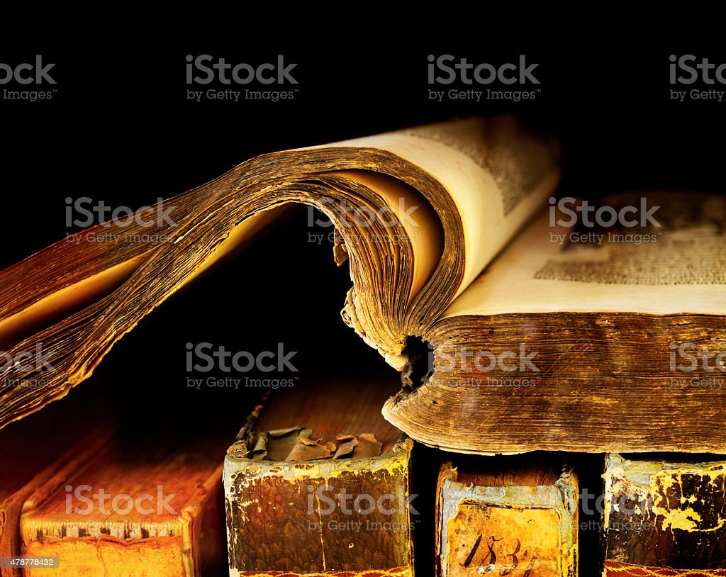 Old and ancient books on a shelf stock photo