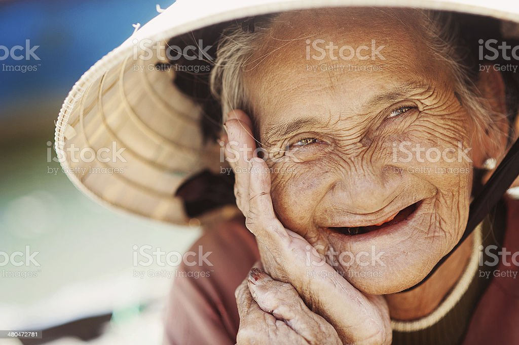 Old and beautiful smiling senior woman. stock photo