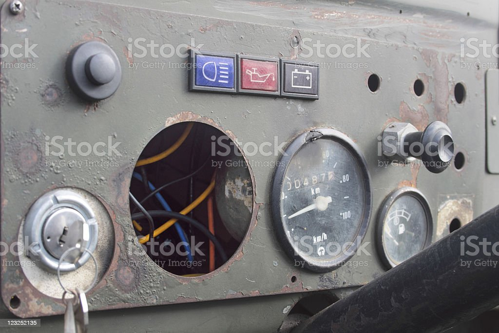 Old and broken jeep panel instruments stock photo