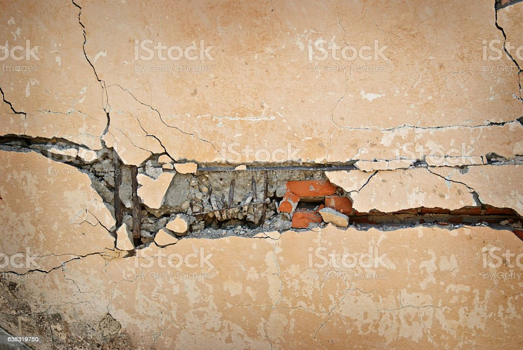 Old and cracked brick wall  background closeup stock photo