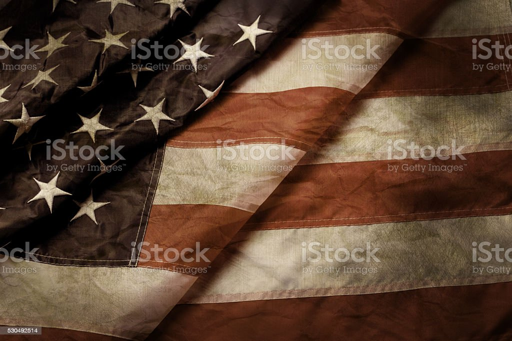 Old and creased US flag. stock photo