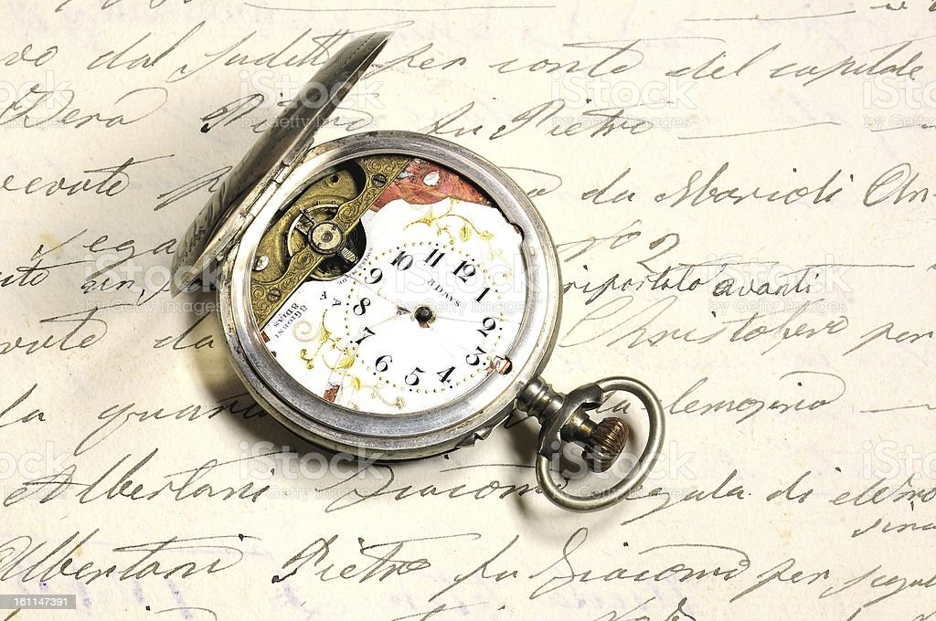 Old and damaged silver pocket watch royalty-free stock photo