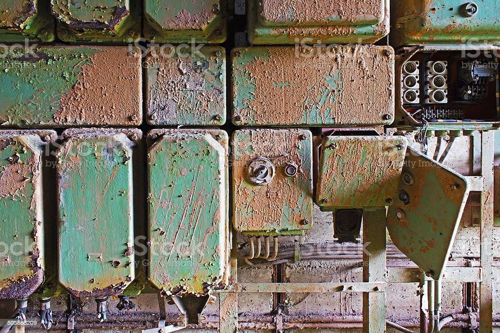 Old and dirty electrical panel on wall stock photo