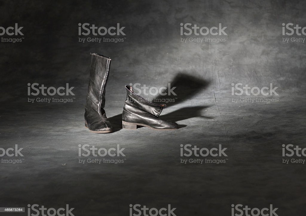 Old and dirty military boots stock photo