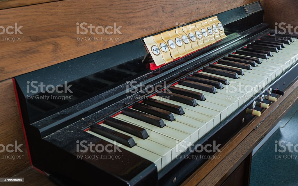 Old and dusty organ keyboard from close stock photo