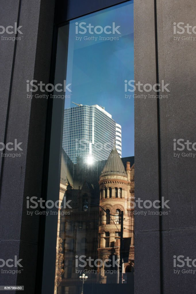 old and new architecture reflected in a window stock photo