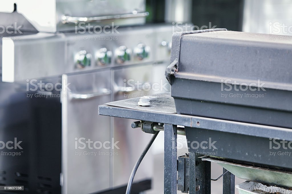 Old and New Home Outdoor Propane Barbecue Grill Appliances stock photo
