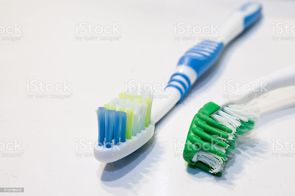 old and new toothbrushes stock photo