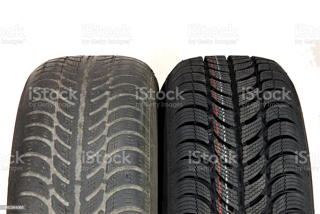 old and new winter car tires stock photo