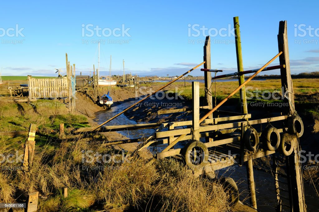 Old and obsolete wooden jetty at Skippool Creek stock photo