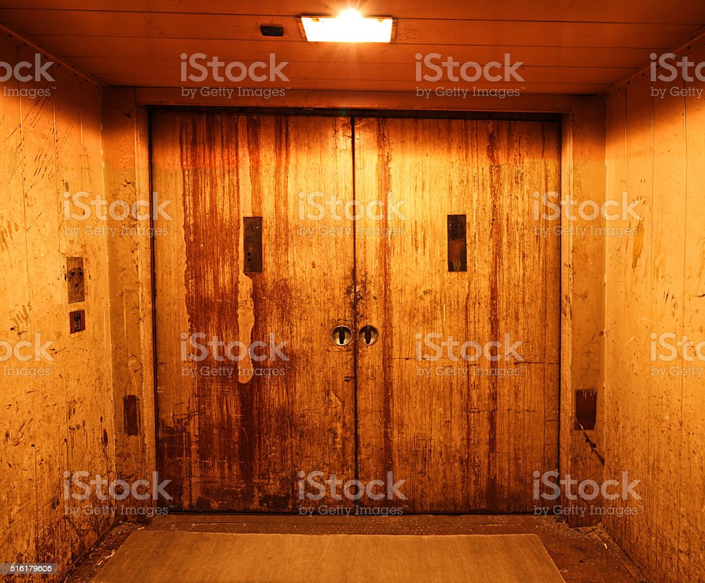 Old and rusty closed elevator doors stock photo