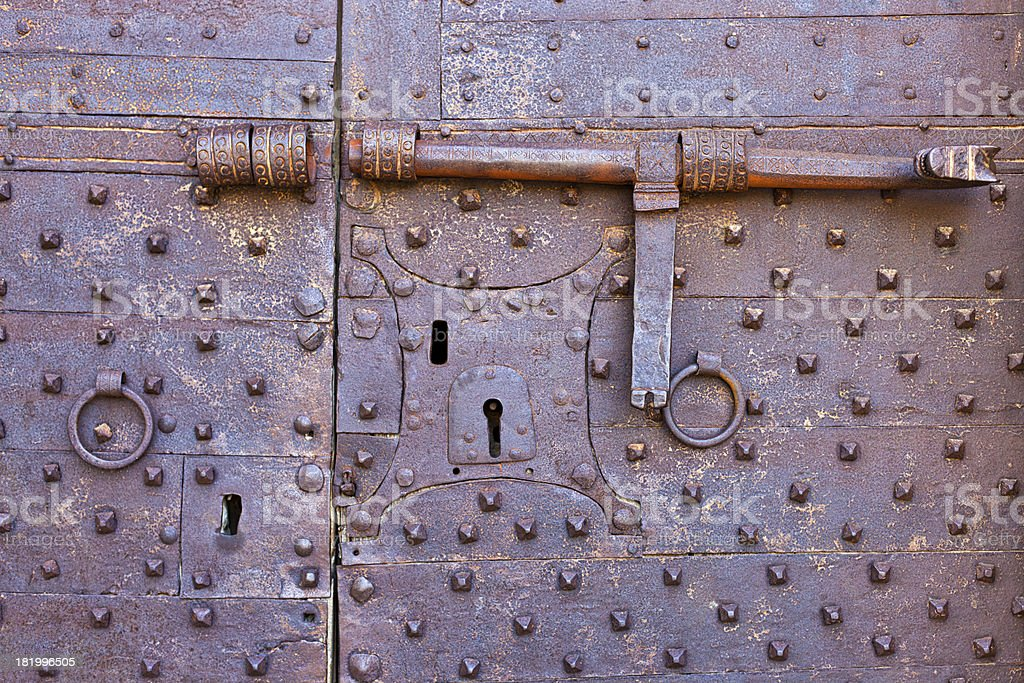 Old and rusty door with many keyholes royalty-free stock photo