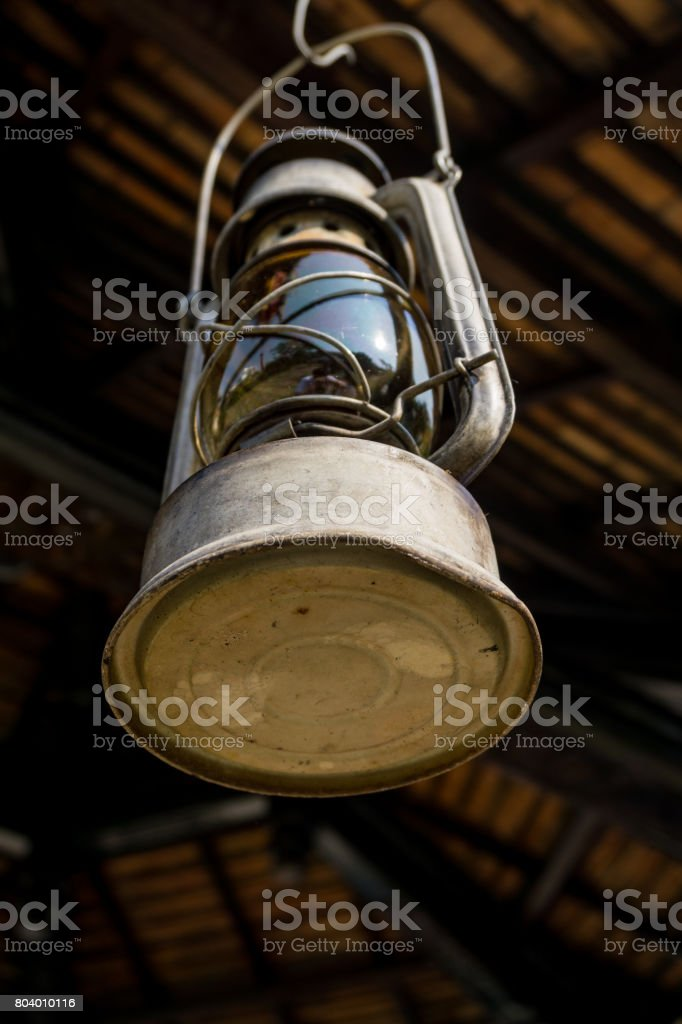 Old and rusty hurricane lamp stock photo