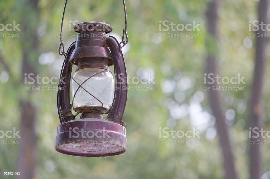 Old and rusty kerosene lantern have bokeh as background stock photo