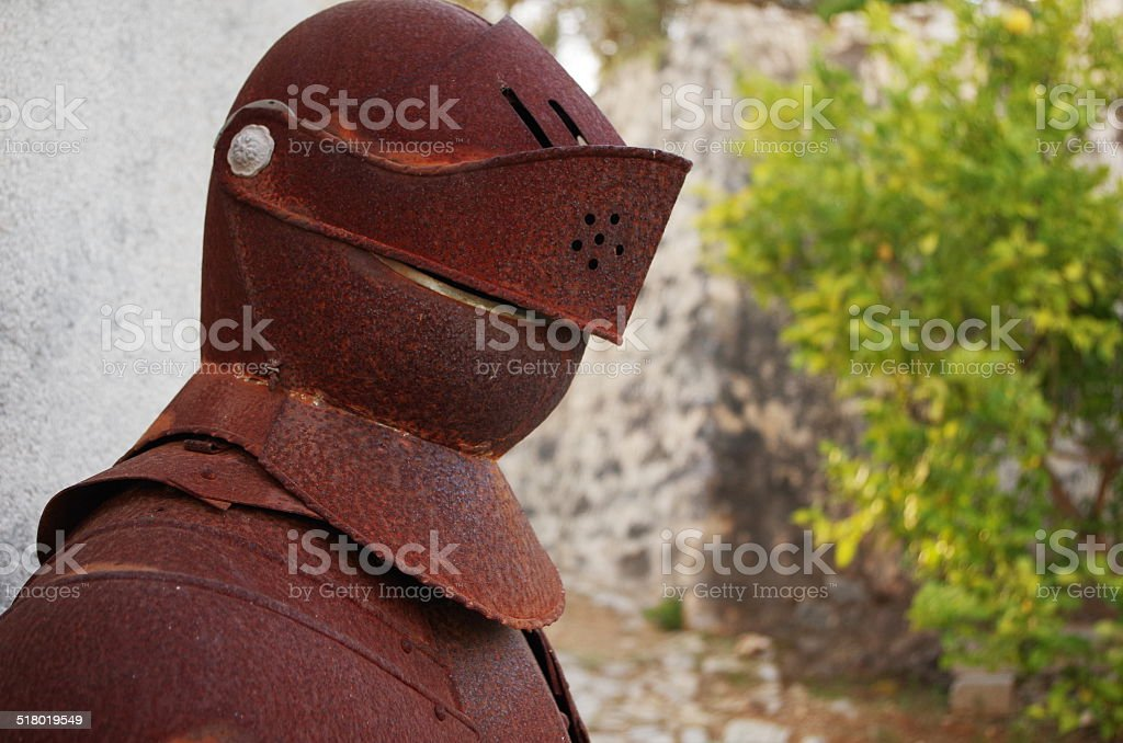 Old and rusty Medieval Knights Armor stock photo