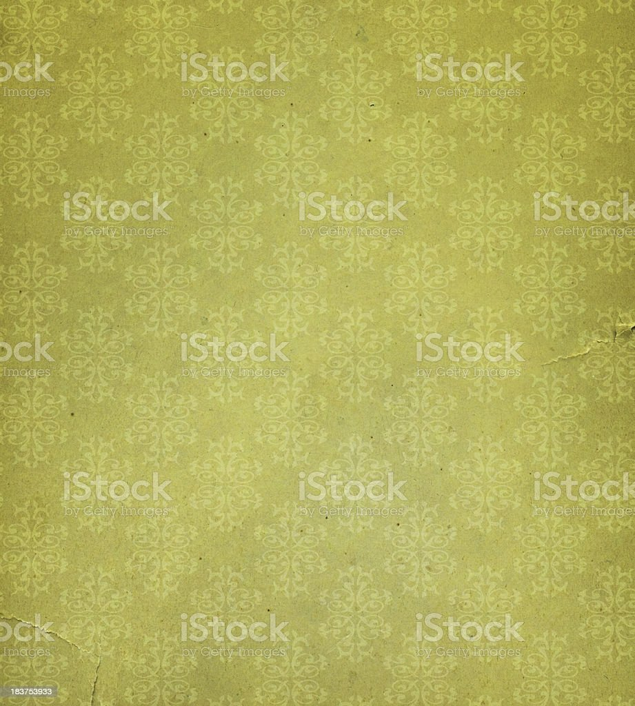 old and torn paper with floral design stock photo