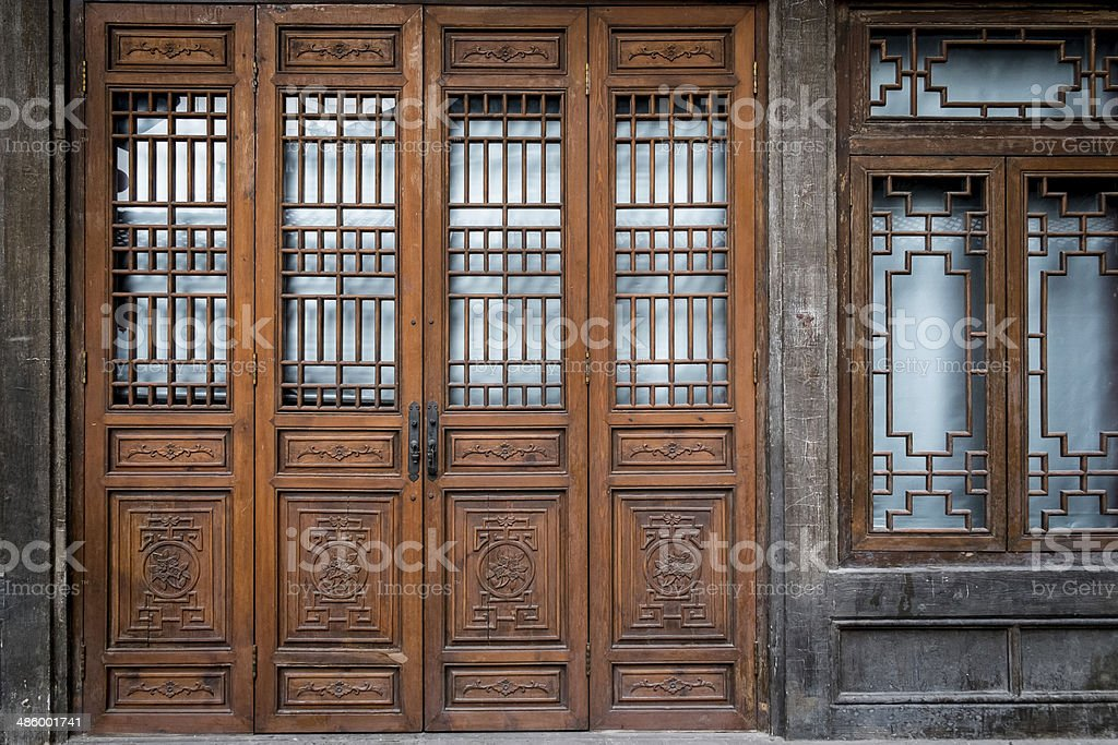 Old and traditional Chinese folding doors. stock photo