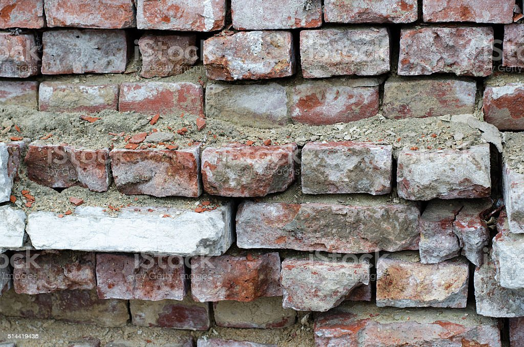 Old and weatherd red brick wall stock photo