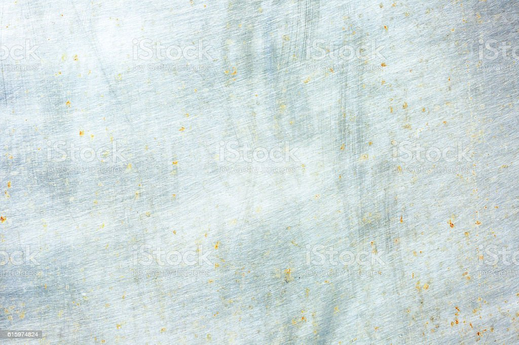 Old and weathered brushed steel plate background with copy space stock photo