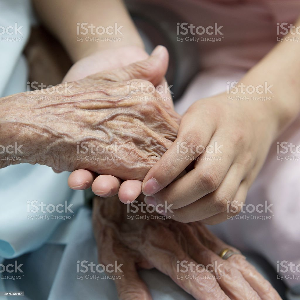 old and young hands stock photo