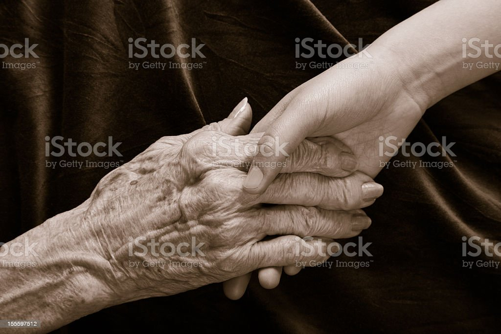 old and young holding hands royalty-free stock photo