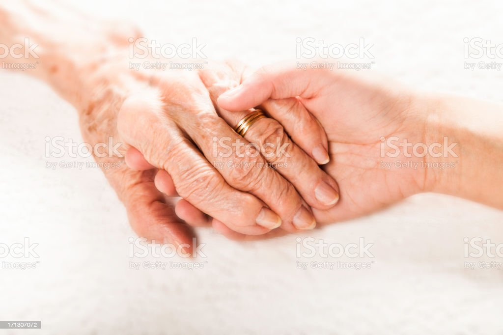 old and young holding hands stock photo