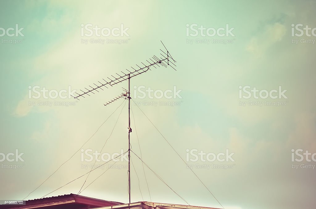 Old antenna with blue sky background stock photo