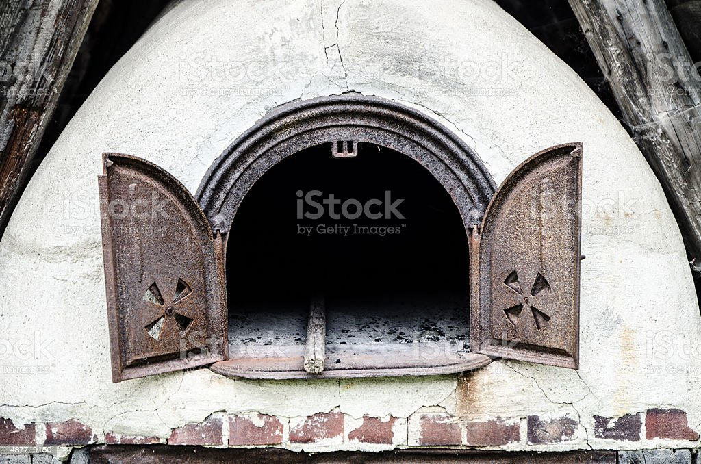 Old antique bread oven in a shed stock photo