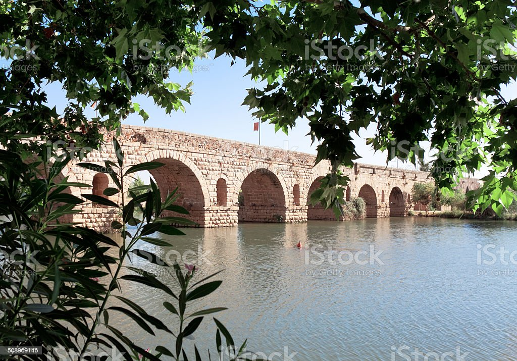 Old antique Bridge on River Guadiana, Merida, Spain stock photo