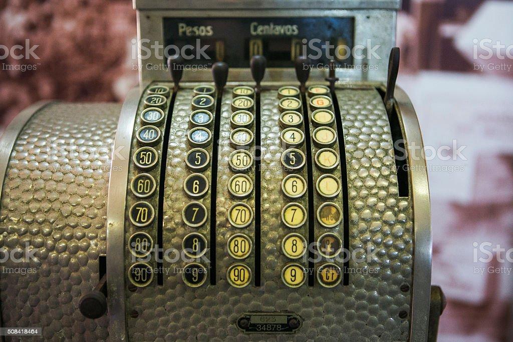 old antique cash register machine in spanish at havana cuba stock photo