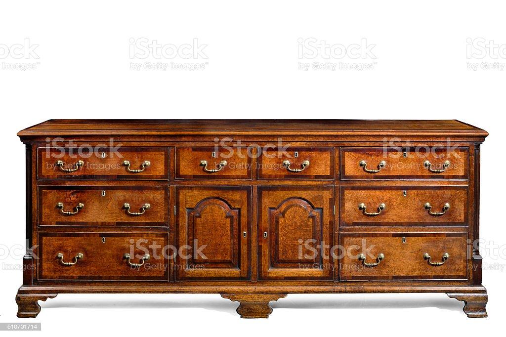 Old antique English oak kitchen dresser base. stock photo
