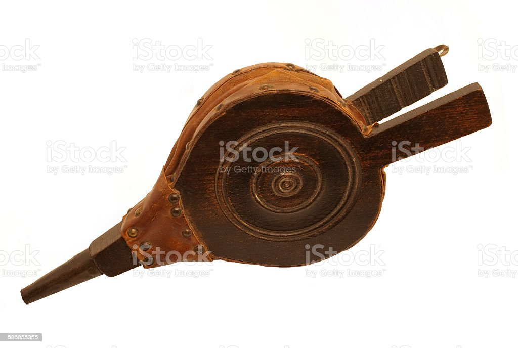 Old antique fire bellows isolated on white background stock photo