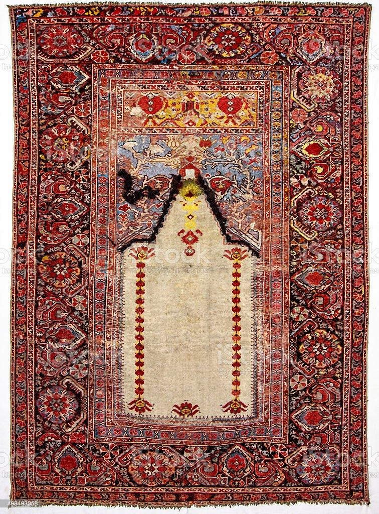 old, antique prayer rugs stock photo