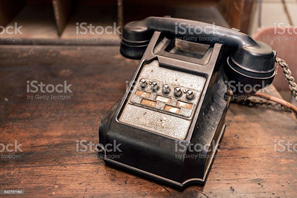 Old antique telephone on desk stock photo