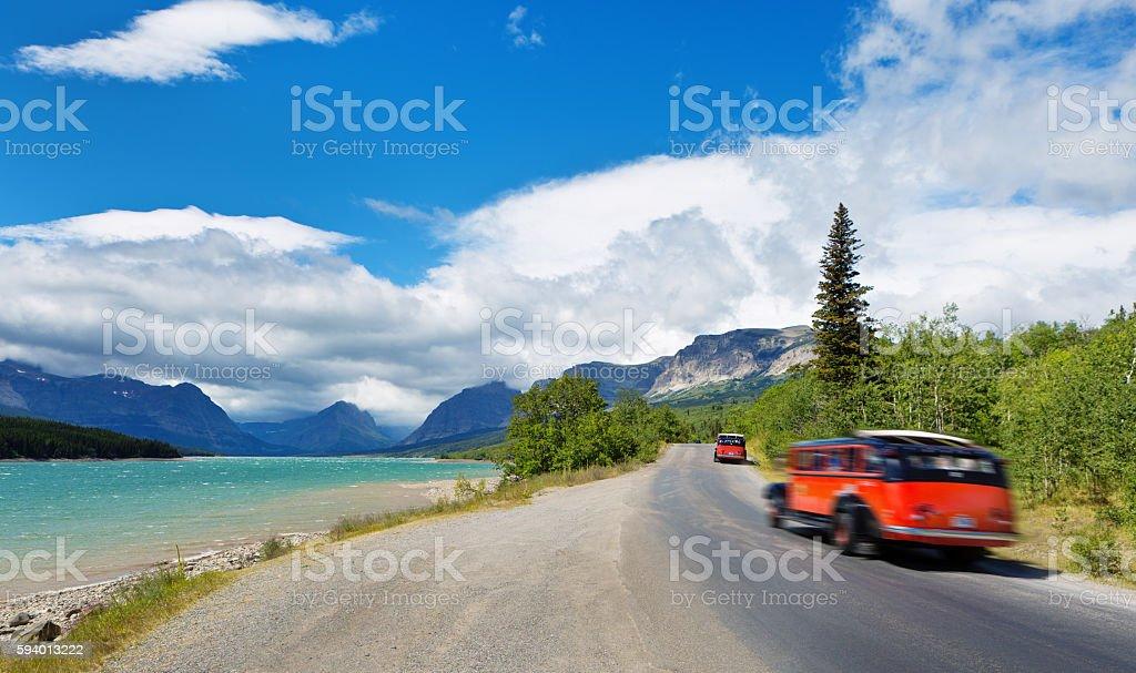 Old Antique Tour Bus Touring Glacier National Park stock photo
