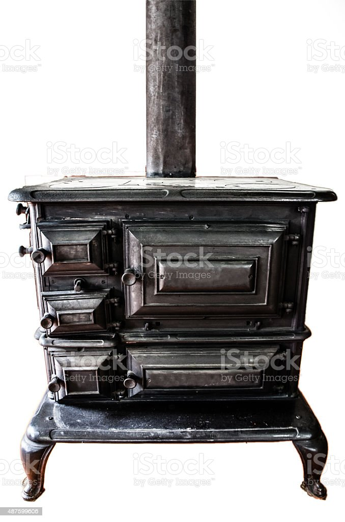 Old antique wood stove isolated on white background stock photo