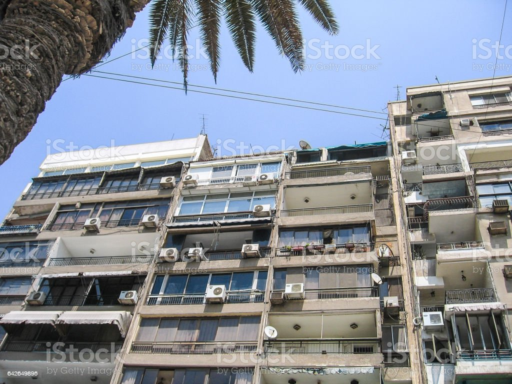 Old apartment building in Cairo, Egypt with balconies, air conditioner stock photo