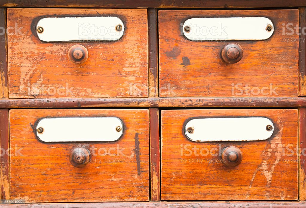 Old Apothecary Cabinet Drawers stock photo