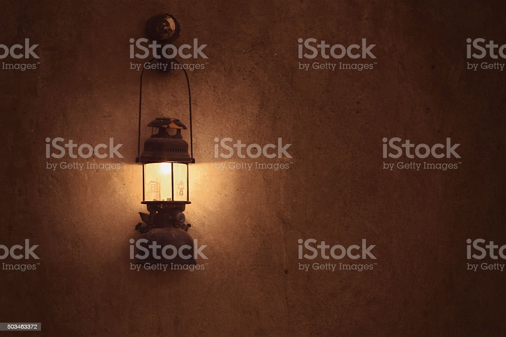 Old arabic lamp on the wall stock photo