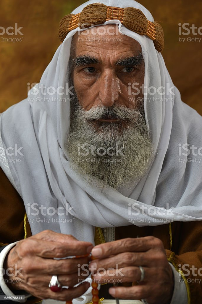 Old Arabic man portrait with traditional clothes stock photo