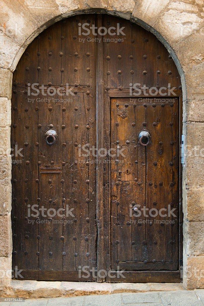 Old Arched Double Door in Cuenca Spain stock photo