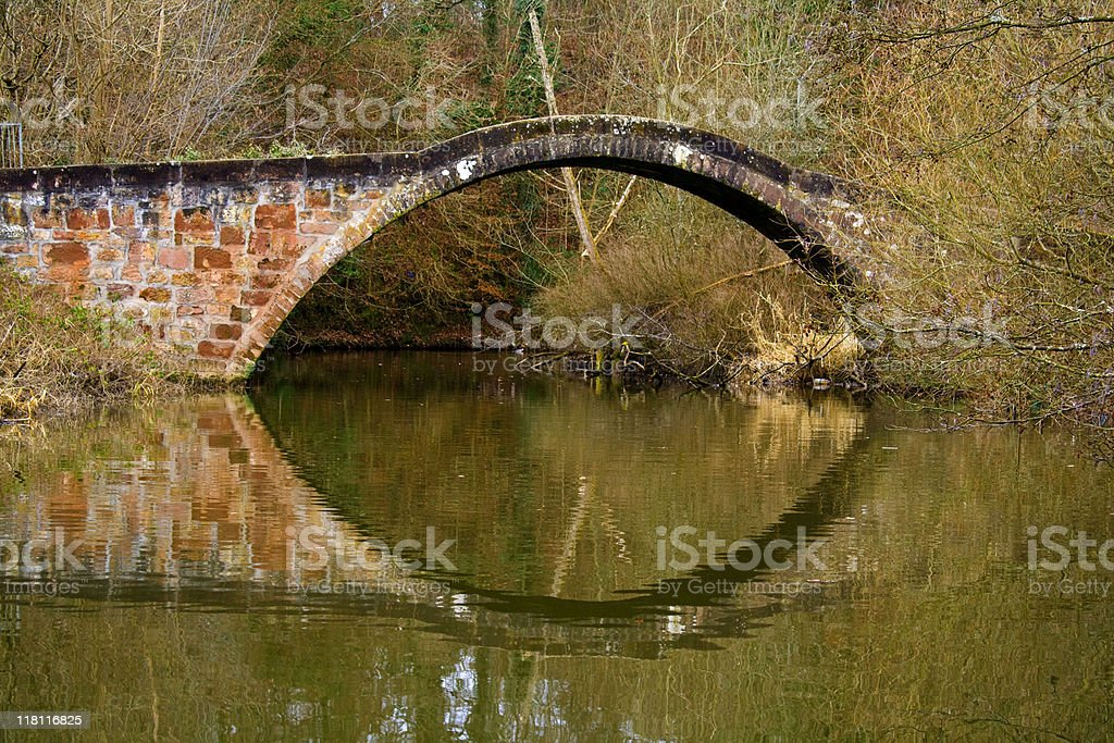 Old Arched Stone Bridge and Reflection stock photo