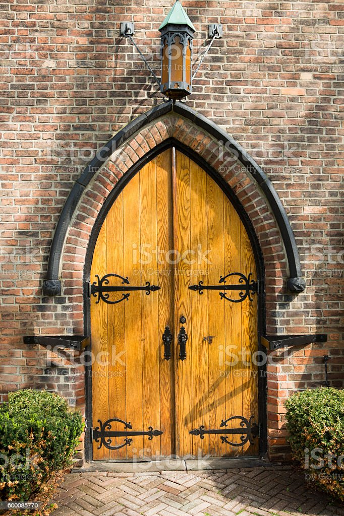 Old arched wooden door stock photo