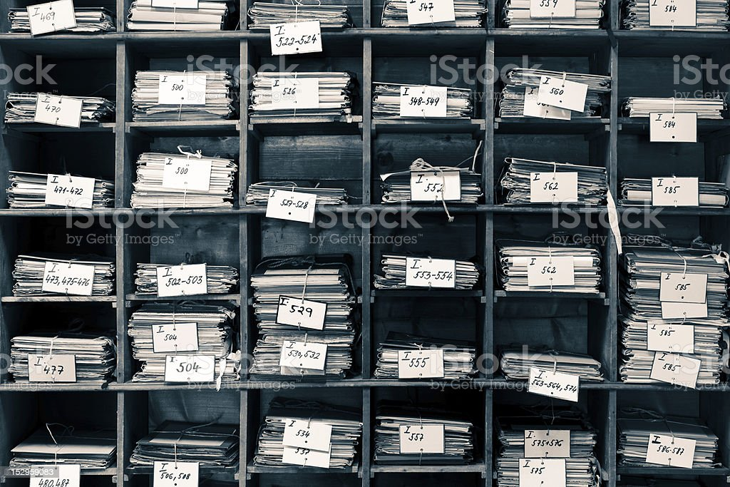 Old archive with publication and documents stock photo