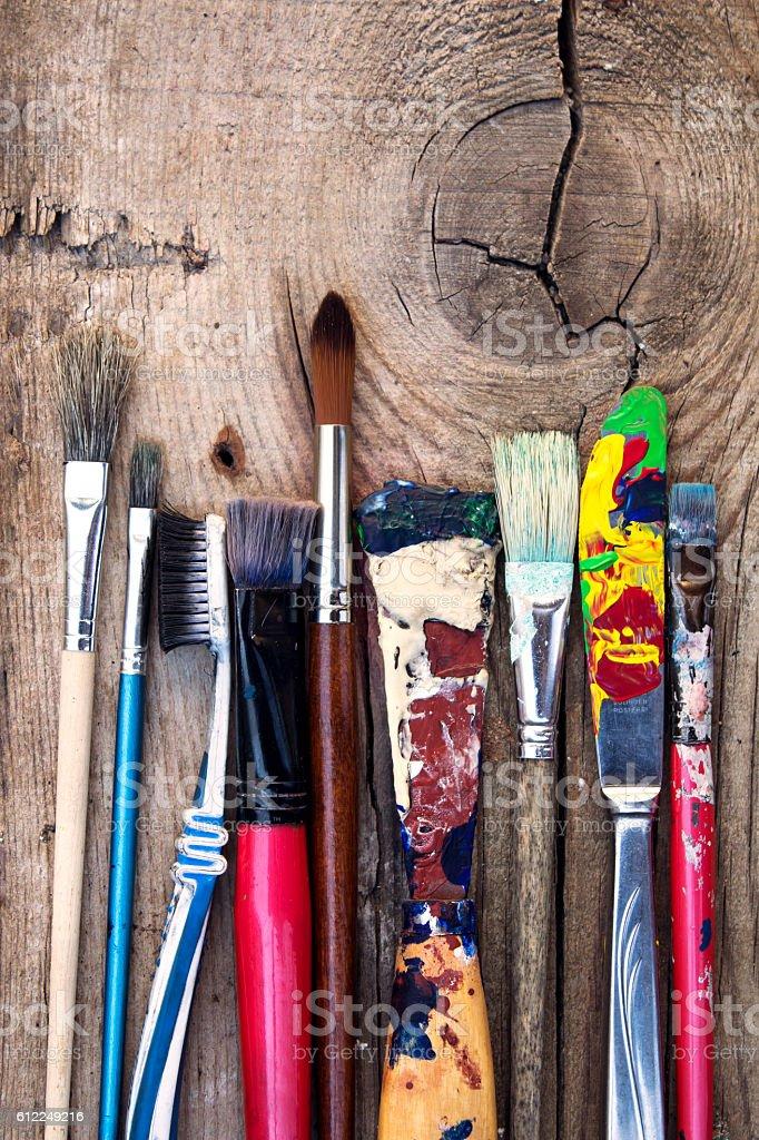 Old art paintbrush set on wooden background stock photo