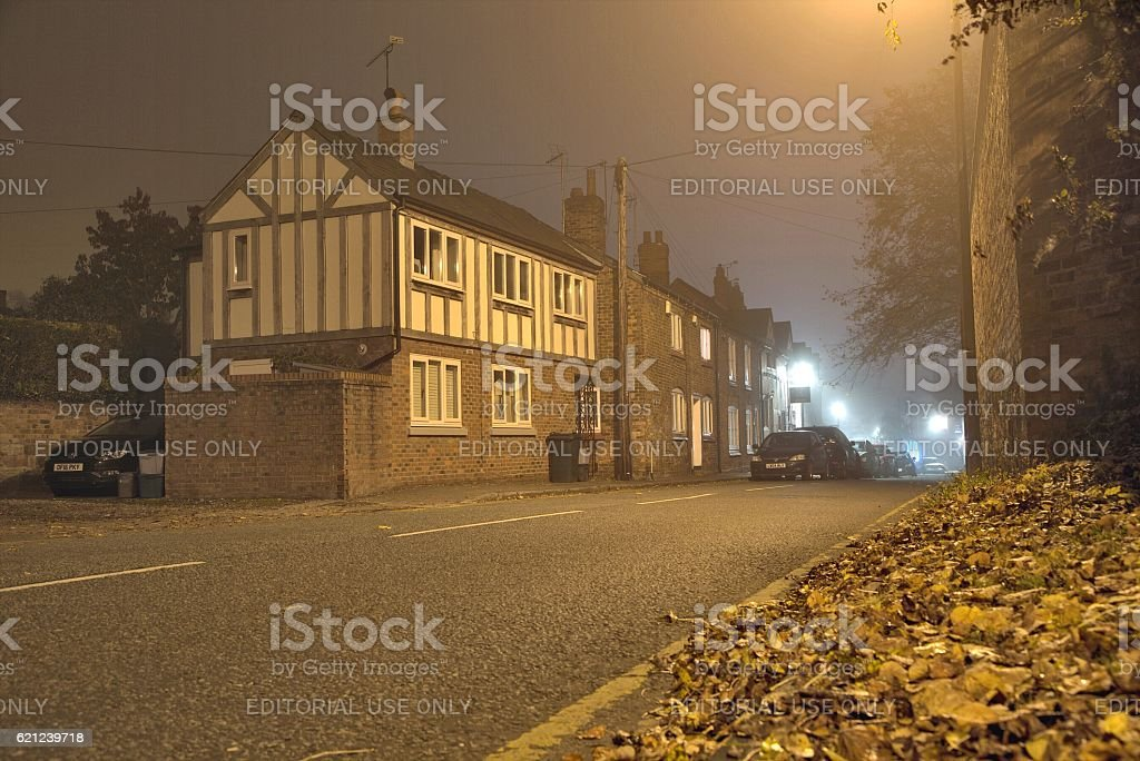 Old arts and crafts house at night stock photo