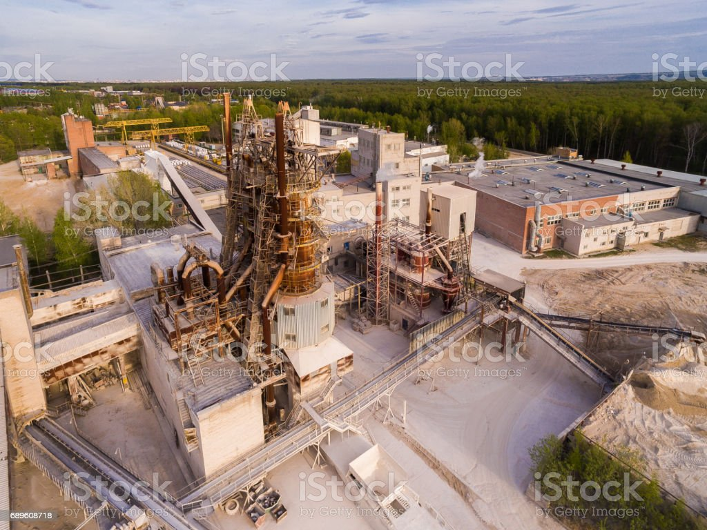 Old asphalt and concrete plant, with large metal structures. Aerial view stock photo