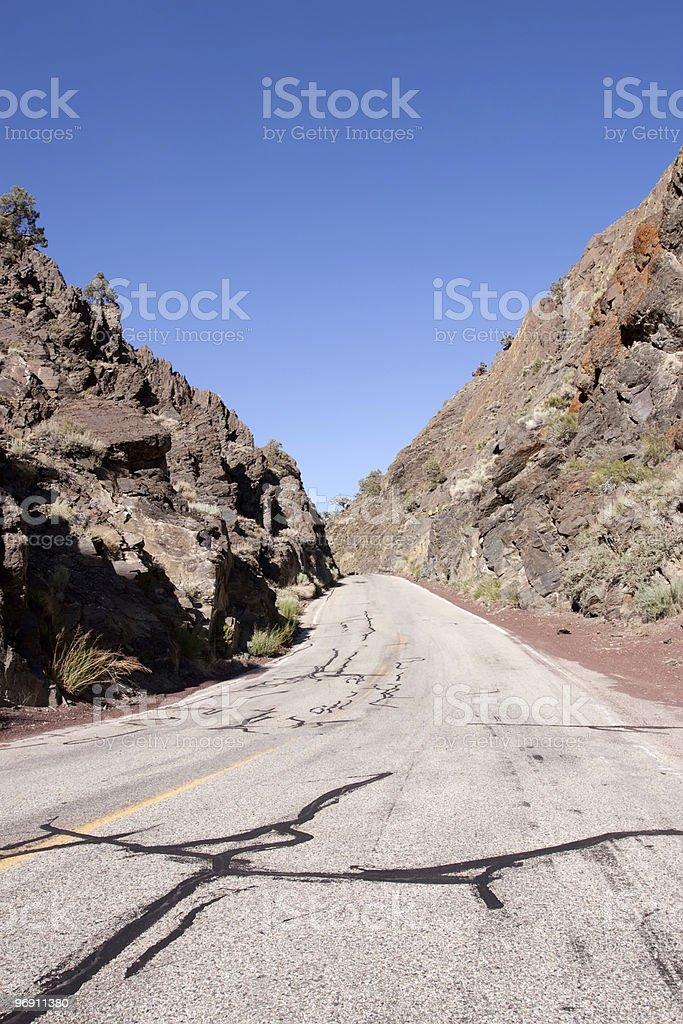 Old asphalt road through mountains stock photo