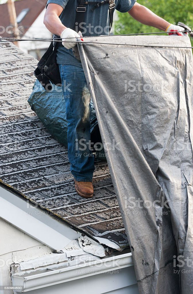 Old asphalt roof shingles being removed for replacemnt stock photo