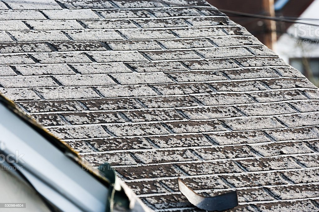 Old asphalt roof shingles stock photo
